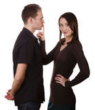 Couple silence shut up. Beautiful young women quiets man, isolated on white Stock Photos