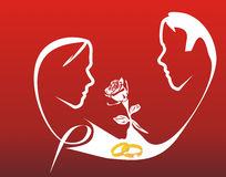 Couple silhouette. White rose silhouette with golden engagement ring Stock Photo