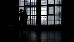 Couple silhouette dancing stock video footage
