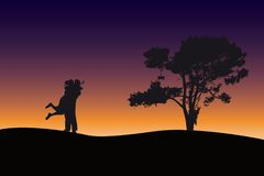 Couple silhouette at dawn. Couple holding each other at dawn on Valentines day Stock Photography