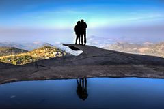 Couple silhouette on the edge of a cliff Stock Images
