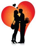 Couple silhouette with hearts Stock Photo