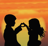 Couple. Silhouette of couple in love at sunset Royalty Free Stock Photos