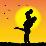 Couple. Silhouette of couple in love at sunset Stock Photos