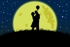 Couple silhouette on moon light Royalty Free Stock Photo