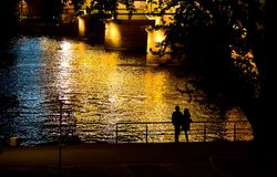 Couple Silhouette near the River at Night Royalty Free Stock Photography