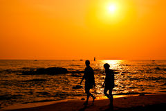 Couple silhouette walking on the beach Royalty Free Stock Photo