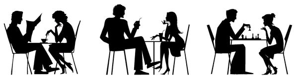 Couple silhouettes near table Stock Photo