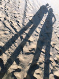 Couple silhouettes on the sand Royalty Free Stock Photo