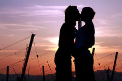 Couple silhouettes at sunset Stock Photo