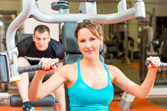 Couple on simulators in the gym Stock Photography