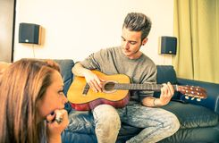Couple sing and play guitar Royalty Free Stock Image