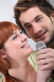 Couple singing karaoke Royalty Free Stock Image