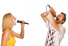 Couple singing karaoke. Isolated on white background Royalty Free Stock Photography