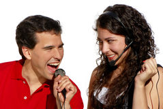 Couple singing karaoke isolated. On white background Stock Photography