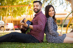 Couple singing together outdoors Stock Photos