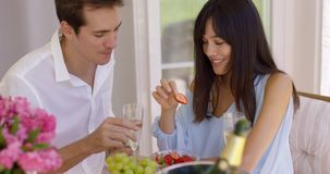 Couple sipping wine and eating fruit stock video