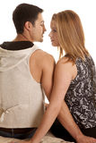 Couple sit back face each other serious Royalty Free Stock Photo