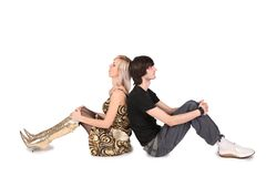 Couple sit back to back Royalty Free Stock Photos