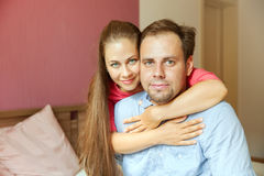 Couple sit on the bed Royalty Free Stock Photos