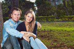 Couple  sit on the grass Stock Photo