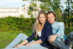 Couple  sit on the grass Stock Images