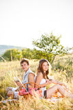 Couple sit on meadow Royalty Free Stock Photos