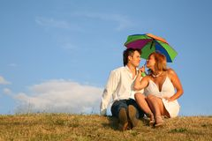Couple sit on the meadow Stock Photo