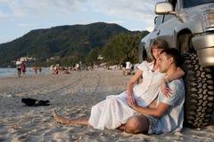 Couple sit near wheel Stock Photo