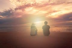 A couple sit on sandy beach. Had-Zai-Med-Rak at Phetcharburi, Thailand Royalty Free Stock Photo