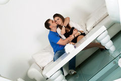 Couple siting on a white sofa Stock Images