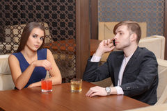 Couple sits in the cafe Stock Photos