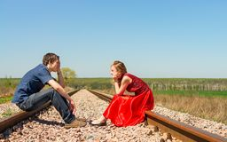 Couple sits on railway Royalty Free Stock Images
