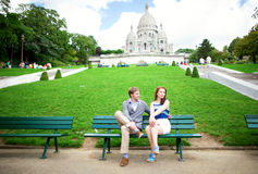 Сouple is sittin on the bench near Sacre-Coeur Stock Images
