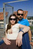 Couple sitting. Relaxed with sunglasses Stock Photo