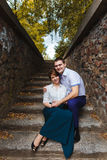 Couple sitting on ancient stairs Stock Images