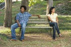 Couple sitting apart.