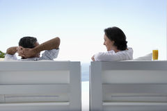 Couple Sitting On Armchairs In Resort Royalty Free Stock Photo