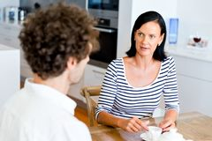 Couple Sitting At Home And Chatting Stock Photo