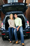 Couple sitting in back of car Stock Photography