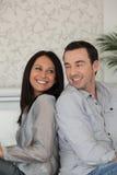 Couple sitting back to back Royalty Free Stock Photos