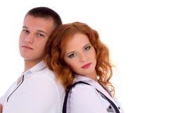 Couple sitting back to back Stock Image