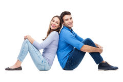 Couple sitting back to back Royalty Free Stock Photography