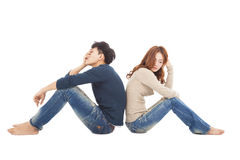 Couple sitting back to back  during  conflict Royalty Free Stock Photos
