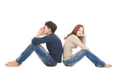 Couple sitting back to back  during  conflict Stock Image