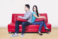 Couple sitting back to back after a fight. On the sofa Royalty Free Stock Photography