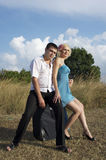 Couple sitting on the bag Royalty Free Stock Photography