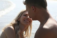 Couple sitting on beach Royalty Free Stock Photos
