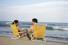 Couple Sitting on Beach royalty free stock images