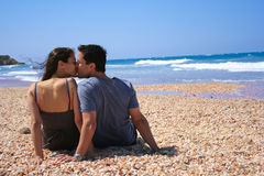Couple sitting on the beach Stock Photography